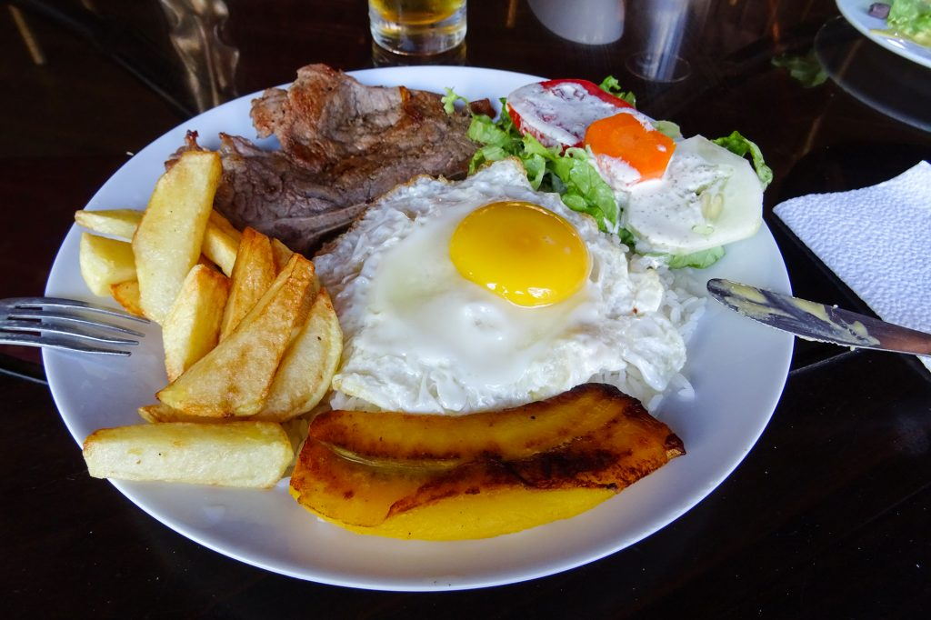 At a menú del dia restaurant in Nazca I had a main course of steak, plantain, egg, chips and salad