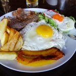 At a menú restaurant in Nazca I had a main course of steak, plantain, egg, chips and salad