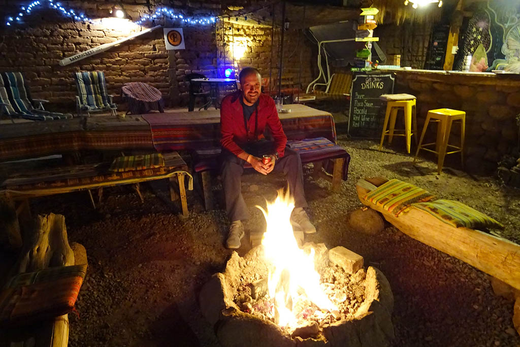 San Pedro Backpackers Hostel has a camp fire with an outdoor bar