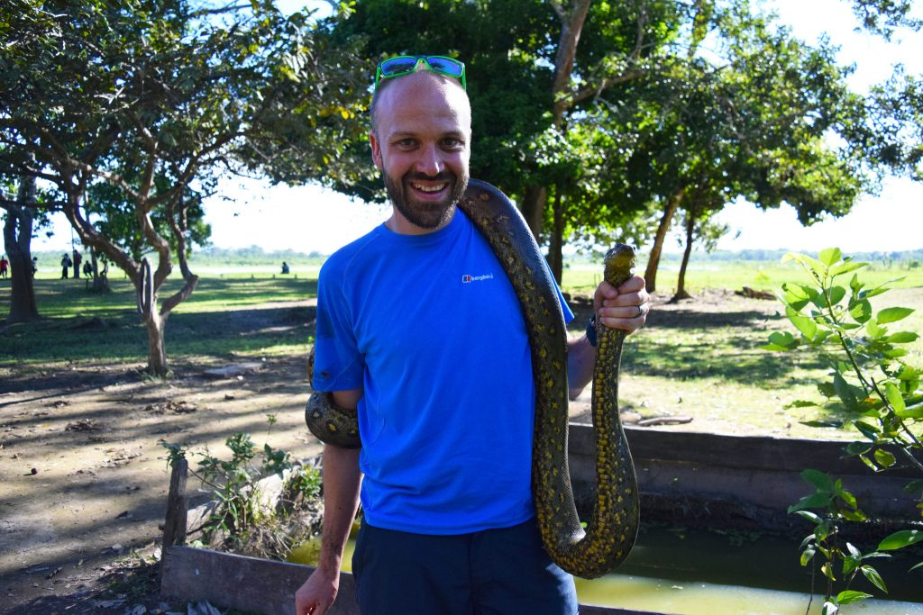 Holding an anaconda on Monkey Island in the Peruvian Amazon