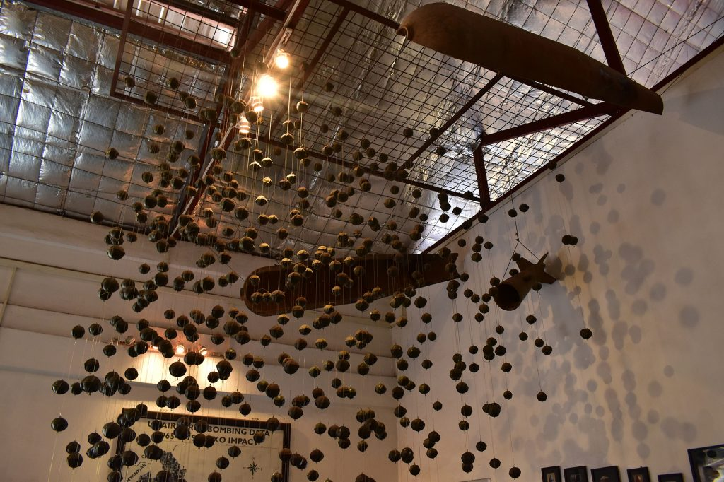 An exhibition of cluster munitions at the COPE Visitor Centre
