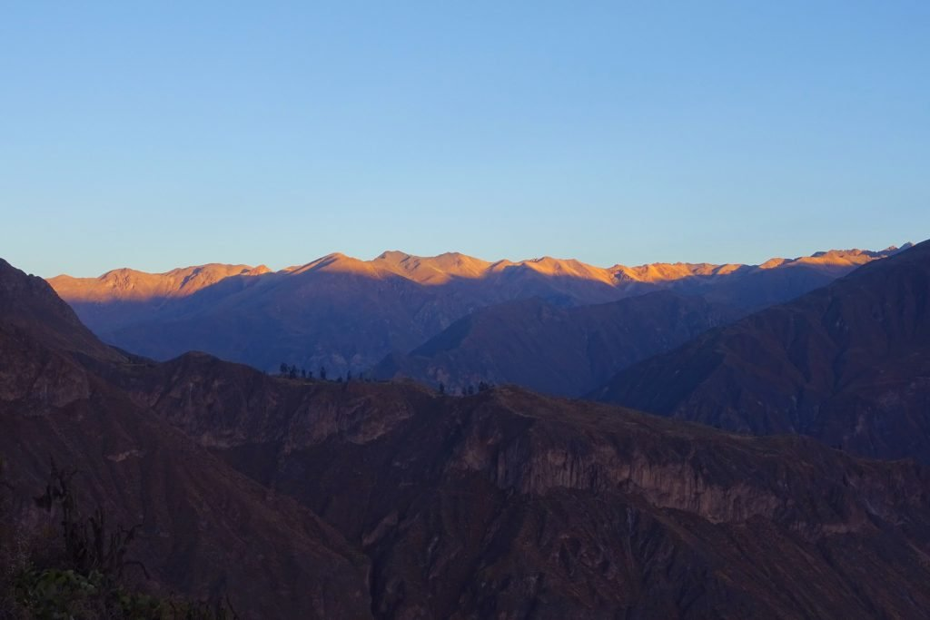 The sunrise kissing the horizon in the Colca Valley at dawn