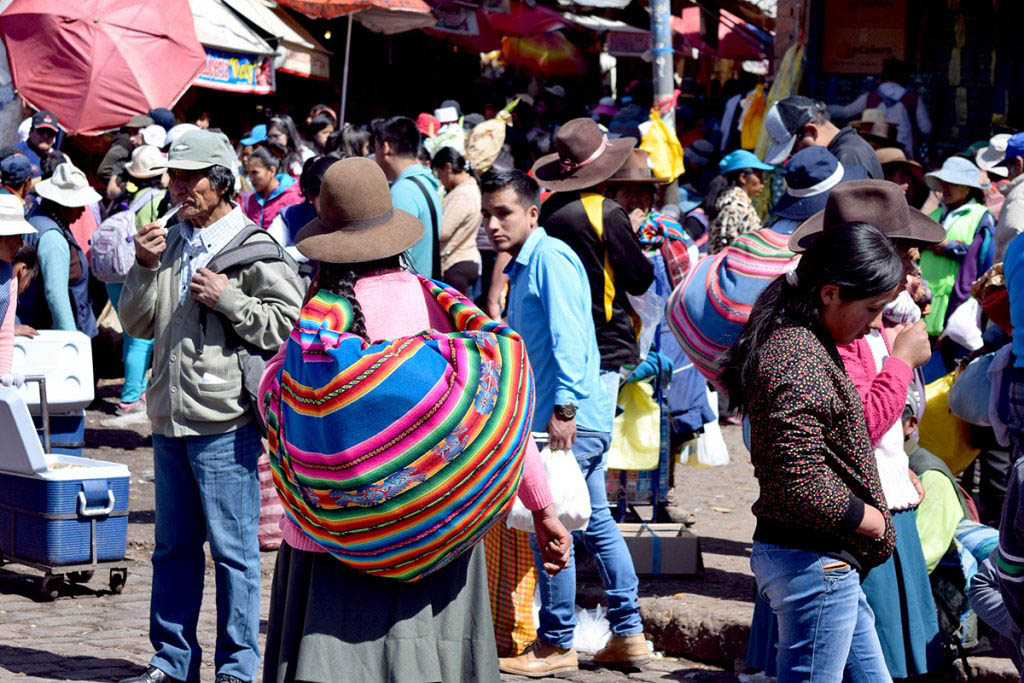 Shopping in the busy street stalls is one of the best things to do in Cusco for a local experience