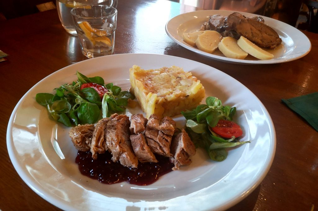 Roast duck breast with cranberry sauce and potato in Prazdroj, Old Town