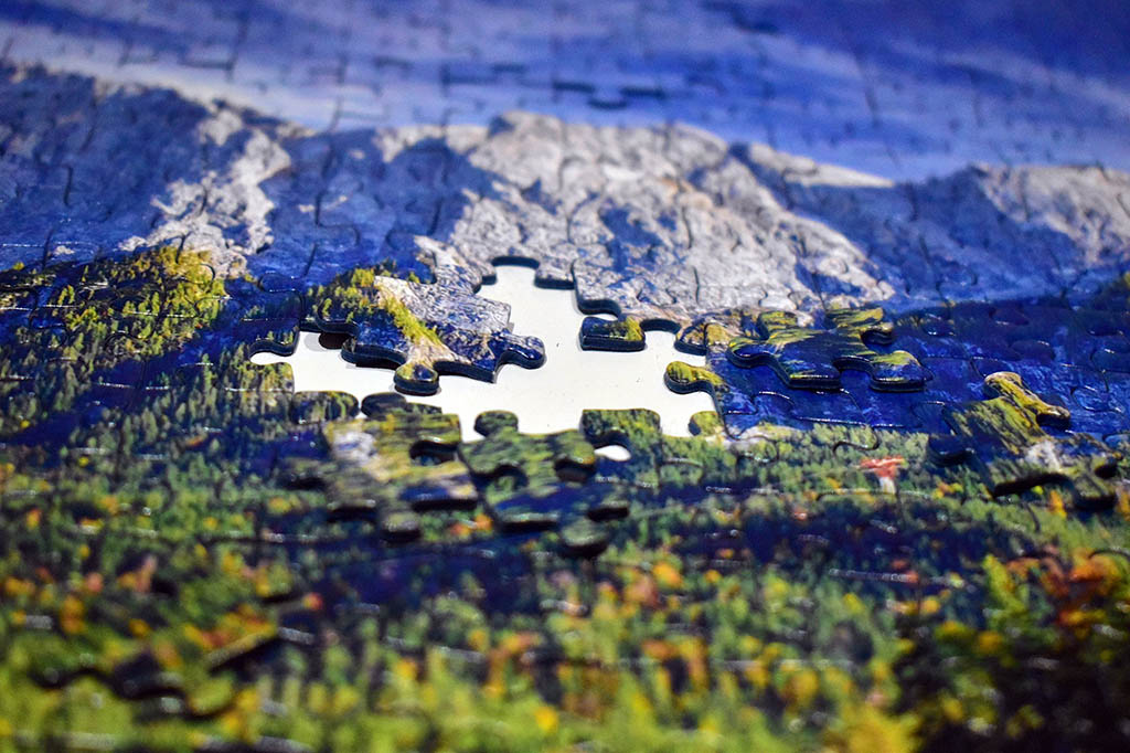 Doing travel-related jigsaw puzzles is a mindful exercise that helps me escape stress