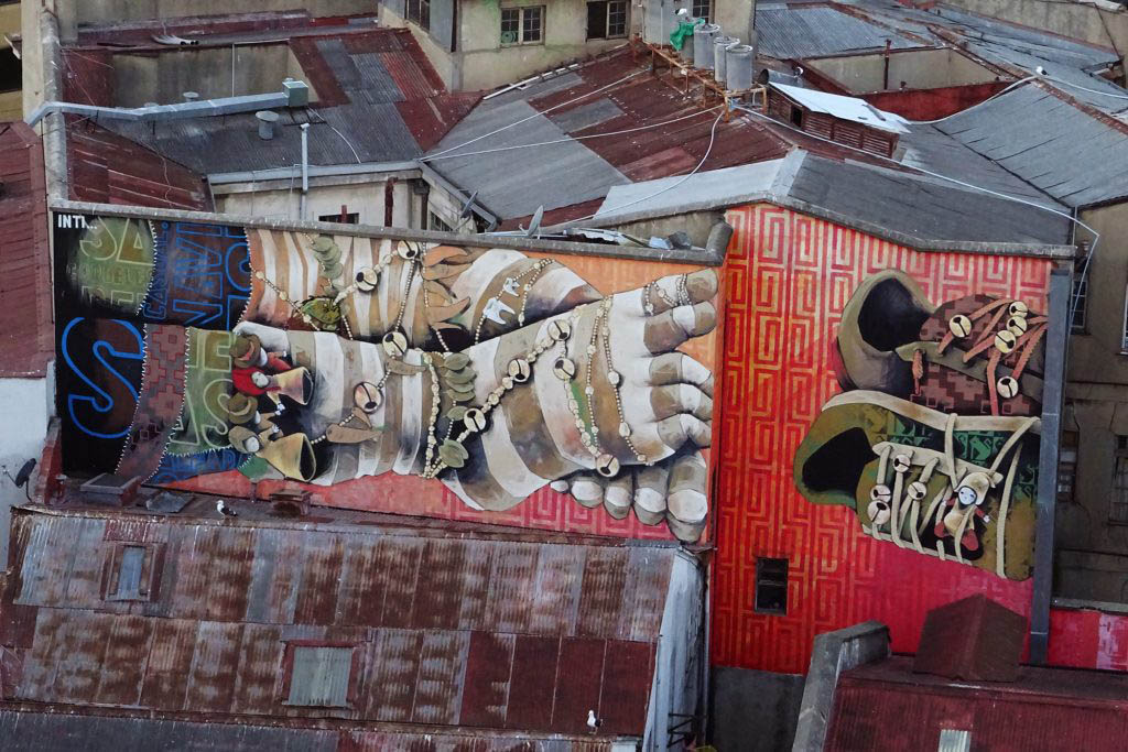 Part of a mural by Valparaíso artist Inti, which is painted across three buildings