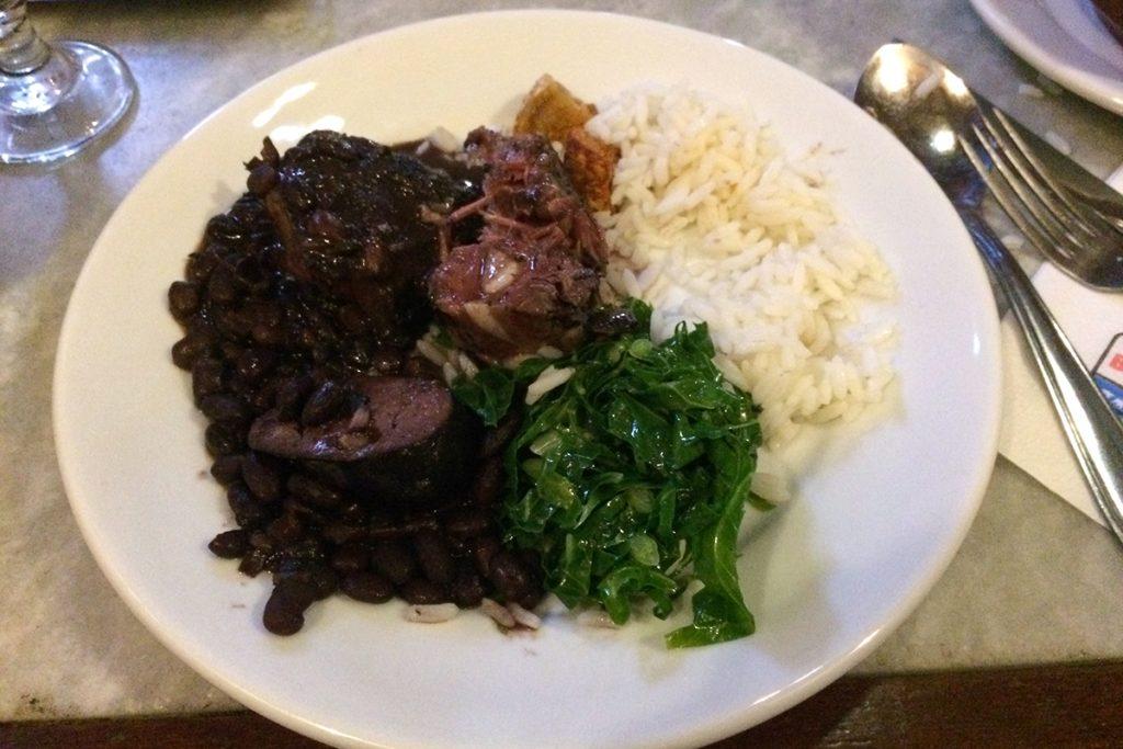 Feijoada, a classic Brazilian dish, at Bar e Restaurante Os Ximenes