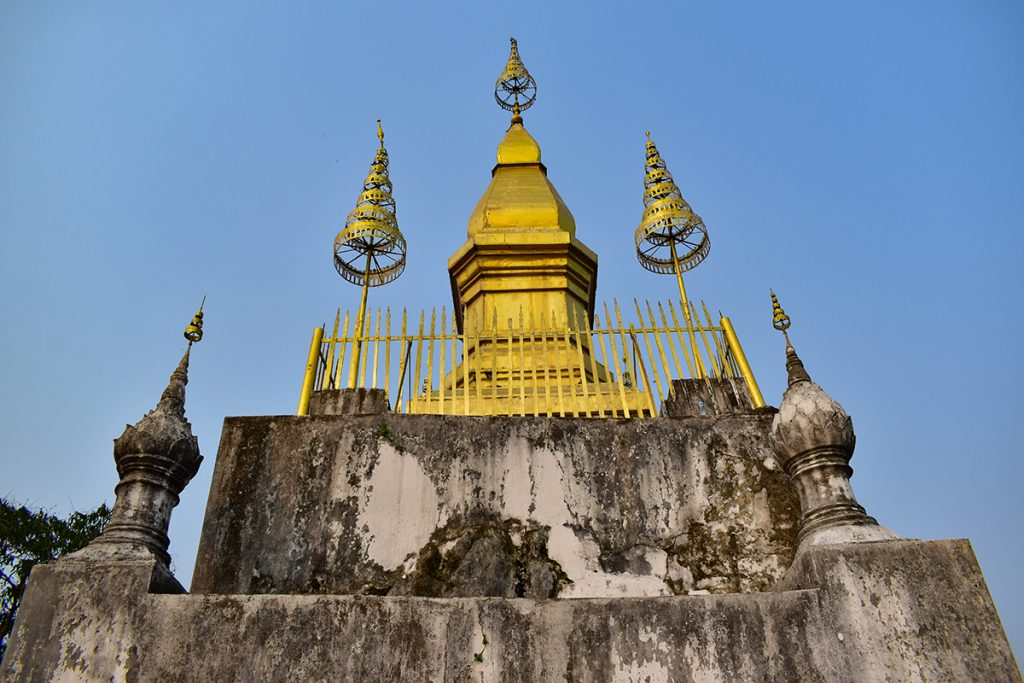 The golden structure of Wat Chom Si, part-way up Mount Phou Si