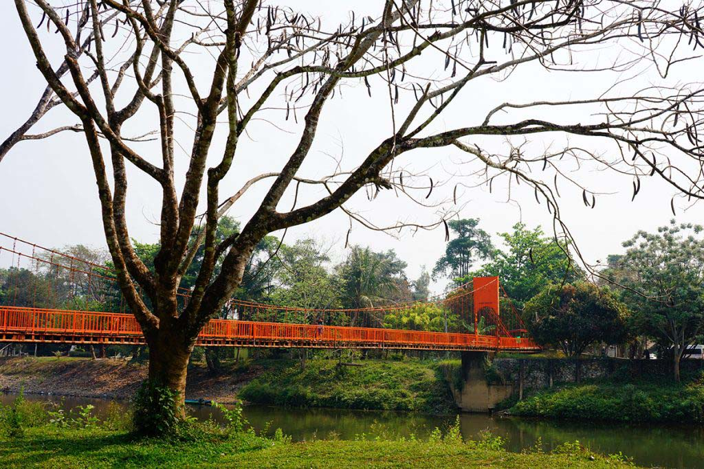 The red suspension bridge by Tham Jang Cave, Vang Vieng