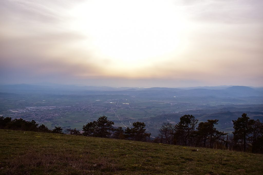From the summit of Monte Subasio you can see the sunset across Umbria