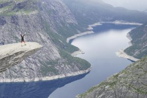 Krista hiking at Trolltunga in Norway during her travel career break