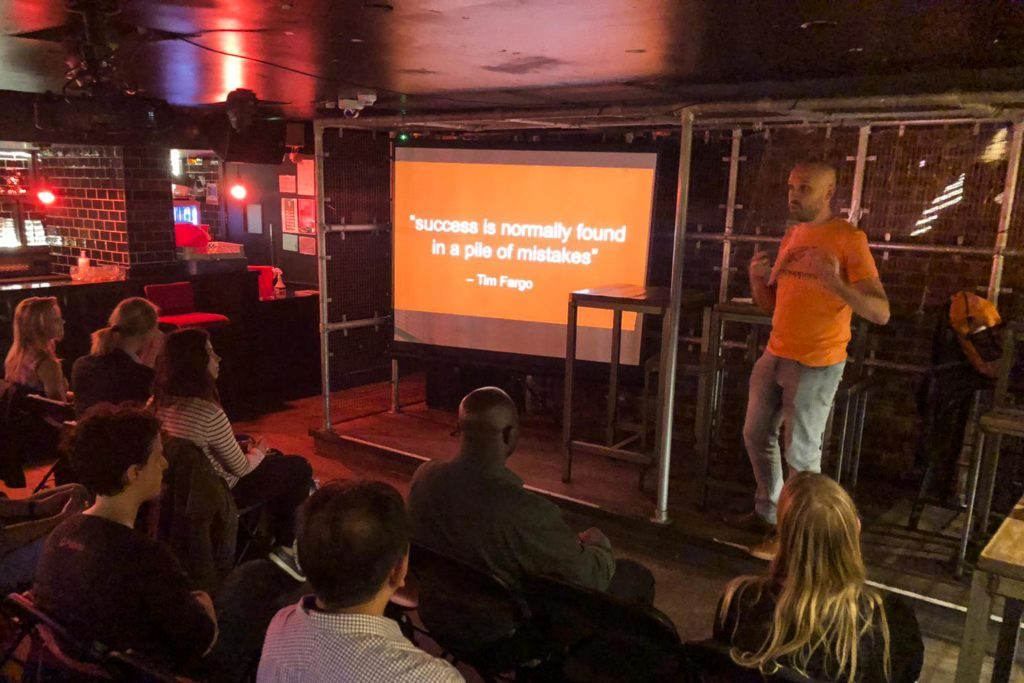 Alex giving talk at Meetup event in London