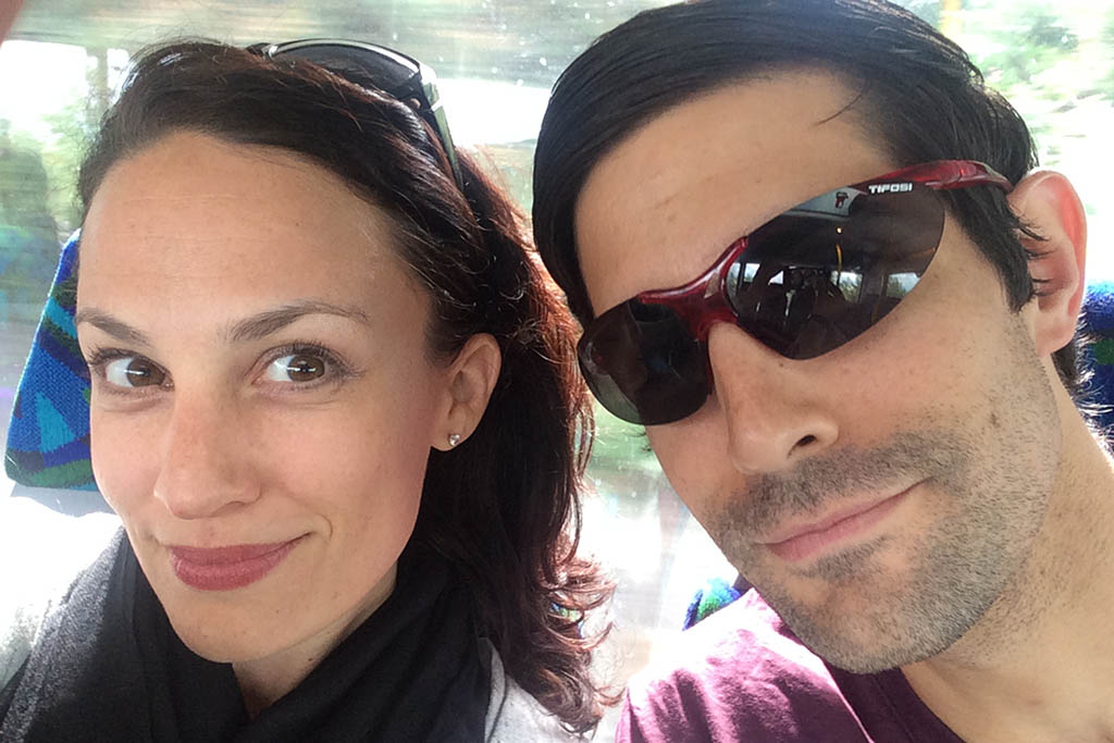 Sarah and Sean on a city bus in Stockholm during their travel adventure