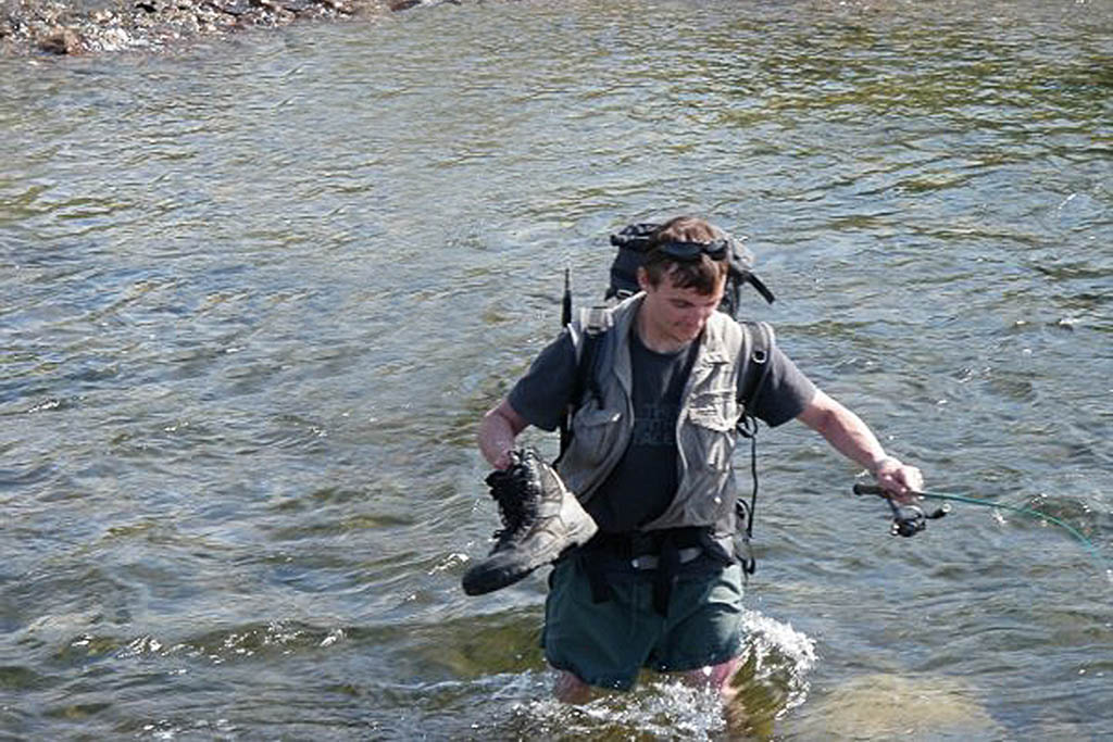 Steve Rohan crossing a river in Siberia, 2009