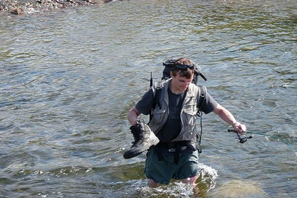 Steve Rohan crossing a river in Siberia, 2009