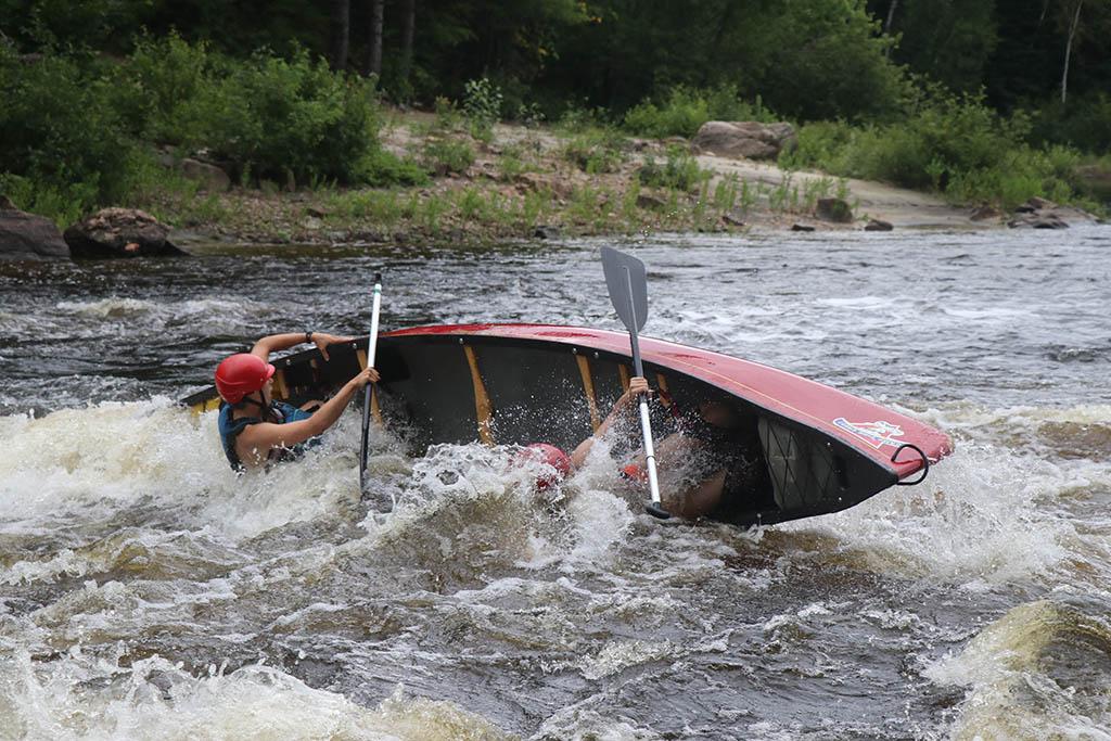 Canoeing Noire River grabbing the gunwales
