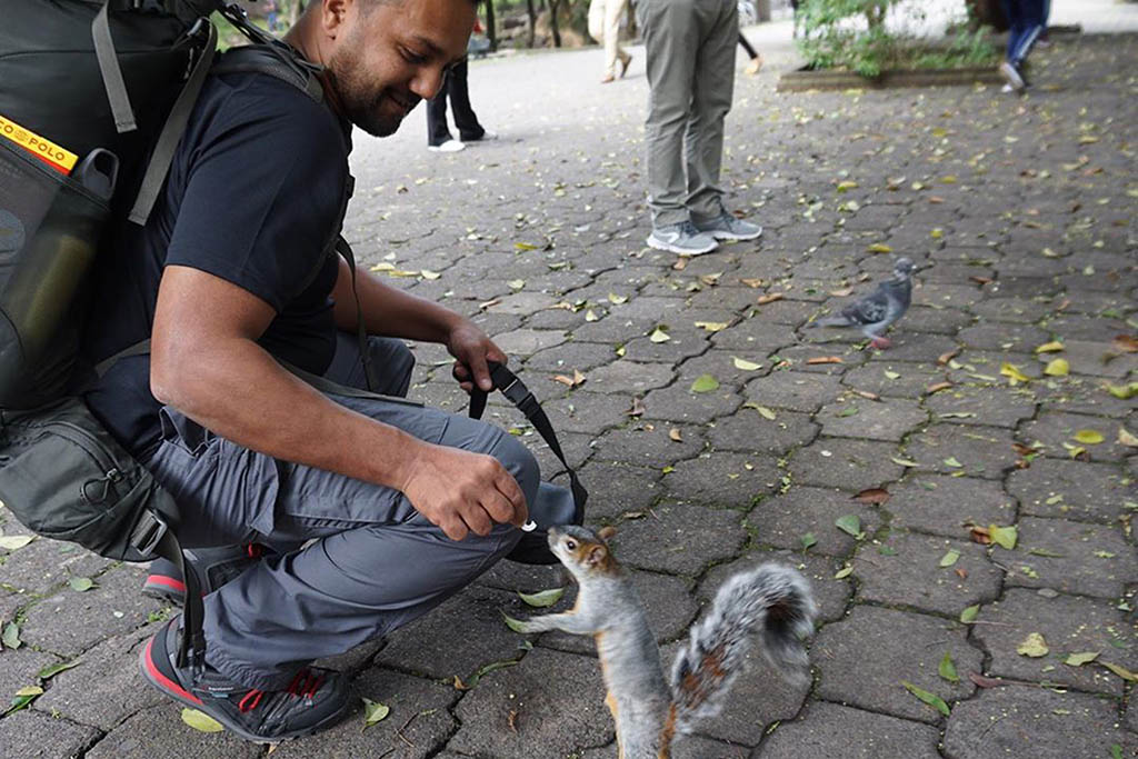 Emon befriending a squirrel in Mexico City, where the Race Across the World journey started