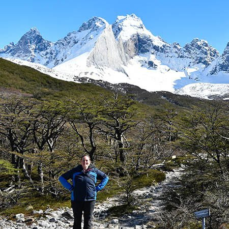Small group tours in South America Lisa hiking in Torres Del Paine silver forest