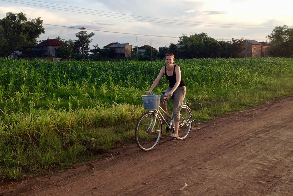 Riding a bike along the river in Kampot, Cambodia, a highlight of Brianne's travels